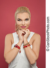 Perfect woman with makeup and golden jewelry portrait