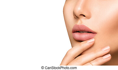 Perfect woman's sensual lips with fashion natural beige matte lipstick makeup