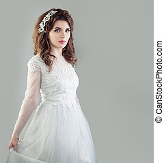 Perfect young bride woman in white wedding dress on background with copy space