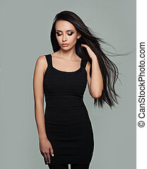 Perfect Young Woman Fashion Model with Long Healthy Blowing Hair. Beauty Salon Background