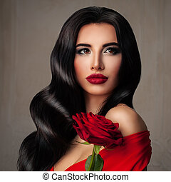 Perfect Young Woman Fashion Model with Long Permed Hairstyle, Red Lips Makeup and Rose Flower
