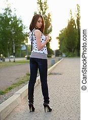 woman standing on the sidewalk