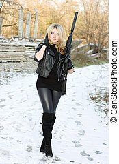 Perfect young woman with a gun