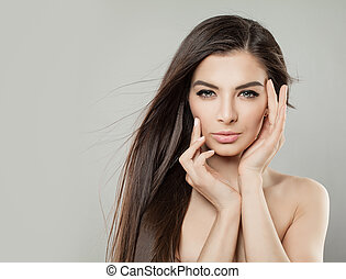 Perfect Young Woman with Healthy Skin and Long Brown Hair. Attractive Model on Background