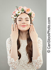 Perfect young woman with natural makeup and flowers beauty portrait
