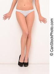 perfekt, kropp, kvinna, henne, vägg, visande, vacker, legs., böjelse, ben