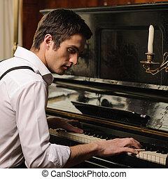 perfil, guapo, joven, elaboración, piano, music., juego, hombre