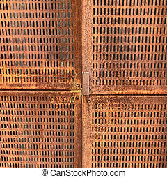 Perforated brass plate natural background
