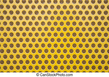 Perforated metal 2 - Close up of perforated yellow ...