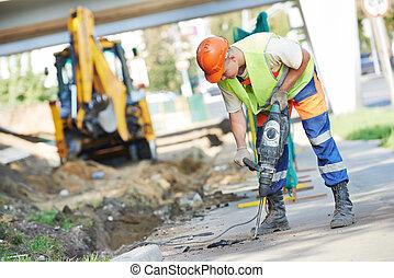 perforator, de arbeider van de bouw