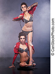 Performance. Couple of Women in Theatrical Costumes. Nightlife