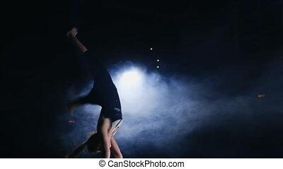 performance in gymnastics female gymnast in uneven bars.