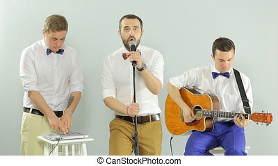 Performance of the musical group in the studio on a white background