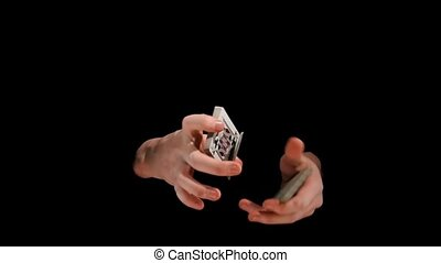 Performance with playing cards on black background, slow...
