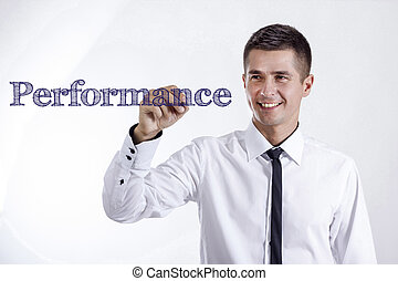 Performance - Young smiling businessman writing on transparent surface