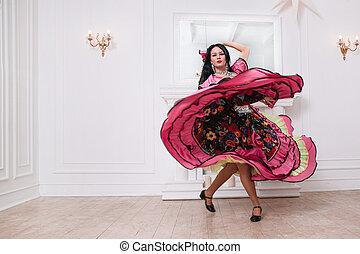 performer of Gypsy dance in a luxurious folk dress