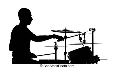 Performer plays professional music on drums. White background. Silhouettes. Side view