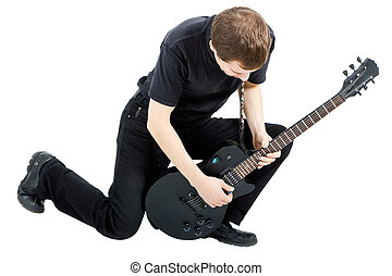 performer with an electric guitar