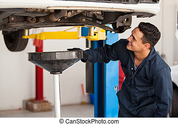 Performing an oil change on a car