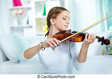 Performing classics - Portrait of a young female playing the...