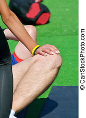 Performing sports massage for athletes.