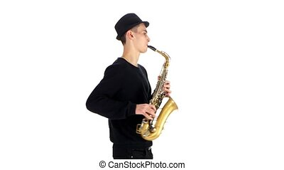 Performs solo on saxophone talented saxophonist. White background in studio
