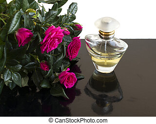 perfume and a bouquet of roses
