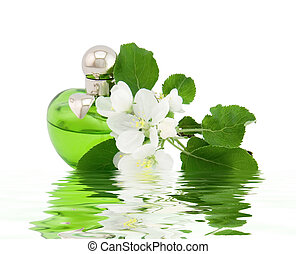 Perfume bottle and apple flower in water reflection on a white background