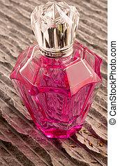 Perfume bottle on a stone background