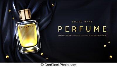 Perfume bottle on black silk fabric background