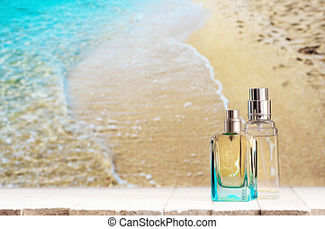 Perfume bottles against sea - Two summer perfumes on white...