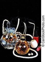Perfume bottles and jewellery.