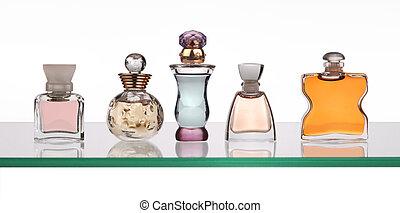 perfume bottles on glass shelf