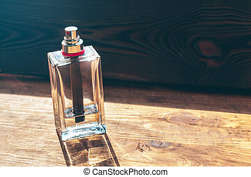 Perfume bottles sprayer on a wooden background