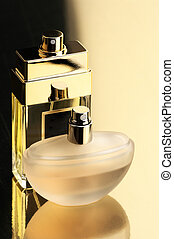 Perfume bottles - Two perfume bottles on gold background...