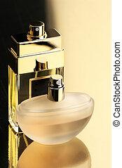 Perfume bottles - Two perfume bottles on gold background...