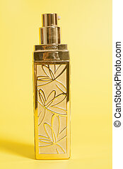 Perfume in bottle on a yellow background