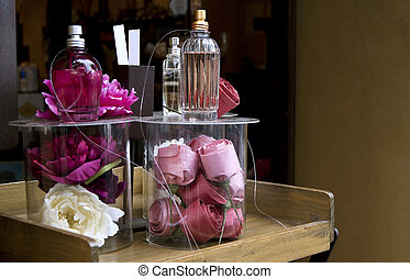 Perfume shop window with roses.