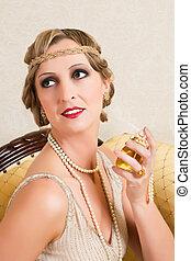 Vintage woman in twenties flapper dress style spraying perfume