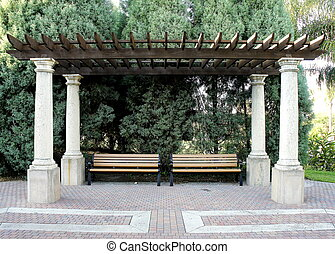 picture of benches under a pergola