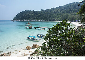 perhentian island beach with boats for transport