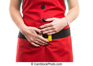 Period or menstrual pain gesture with hands on lower abdominal area