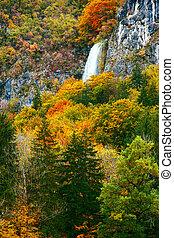 Periodic incredible waterfall in the autumn mountains