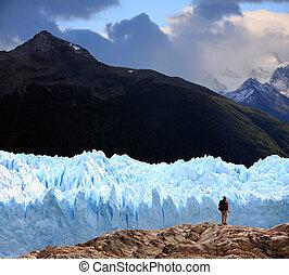 A man looking at Perito Moreno Glacier, Patagonia, Argentina