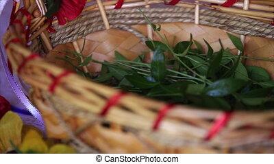 periwinkle leaves in a wicker basket.