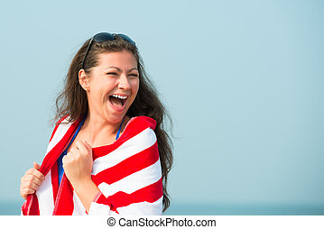 perky laughter of a beautiful girl on the beach