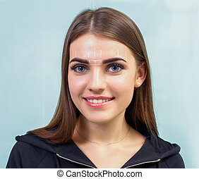 Permanent eyebrow make up. - Cosmetologist preparing young...