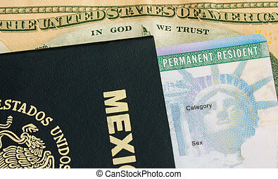 A permanent resident card - Green card and a passport of Mexico. On the background a dollar bill from the United States of America
