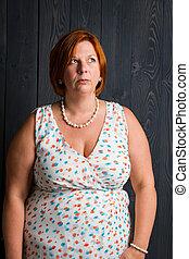 Perplexe woman in a summer dress