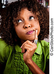 Portrait of perplexed young African American woman
